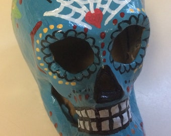 Hand-painted paper mâché sugar skull in teal