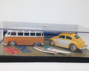 Volkswagon Bus and Bug with surfboards