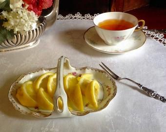 Vintage porcelain tray for lemons or bonbons at your next high tea.  Austrian handled tray with rosebud garlands and gilt