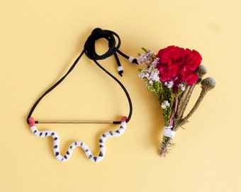 Jane 'little wiggle' porcelain necklace with red highlights