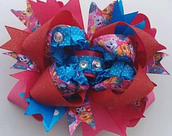 """OTT Boutique Paw patrol hairbow featuring ribbon with Skye, Everest, and Zuma! Handmade OTT stacked boutique hairbow 6"""" X 4"""" size XL"""