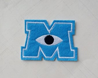 6.2 x 4.4 cm, Monster Inc - Blue M Logo Iron On Patch (P-513)