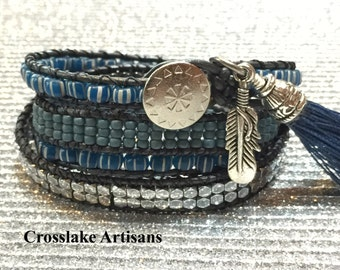 Four-wrap blue and silver beaded bracelet with charms