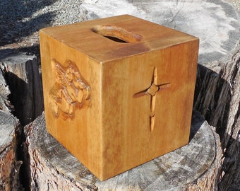Handmade tissue box cover with hand carved angel and crosses in medium wood finish.
