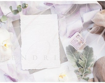 Deckled edge wedding invitation stationery mockup with purple lilac marbled silk ribbon and purple velvet ring box