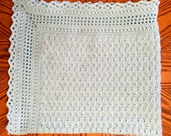 Hand-crocheted, sky-blue heirloom baby blanket