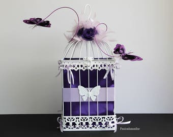 Birdcage wedding with butterfly ribbons feathers flowers urn