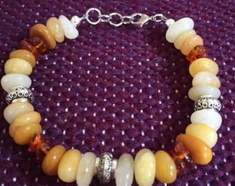 Amber and Red Aventurine beaded bracelet. 7 inch