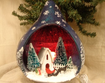 Hand crafted and painted gourd art luminary diorama of church, trees and sleigh by Debbie Easley