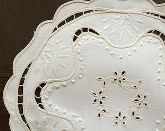 Vintage beige embroidered round doily