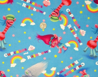 Springs Creative - Trolls - 16146 - Trolls with Cupcakes and Rainbows on Blue - One Yard of Fabric