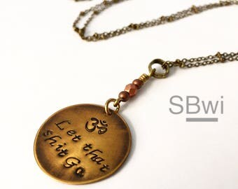 let that sh*t go necklace with copper detail in bronze