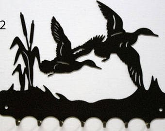 Key grip metal pattern: ducks