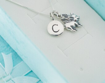 "Little girl's flying pig necklace in sterling silver on a 14"" sterling silver box chain and personalized with sterling silver initial charm."
