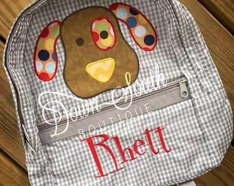 Grey gingham puppy backpack