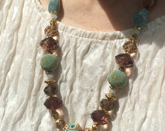 Elegant gold, aqua, and smoke necklace and earrings set