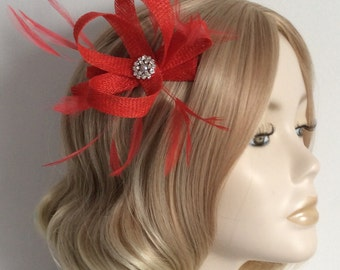 RED FASCINATOR, Made of Sinamay, with stripped hackle feathers, Crystal and pearl, on a clip