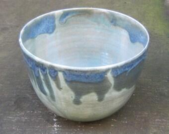 Handmade ceramic bowl with blue and green glaze