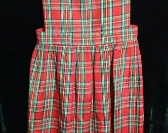 An adorable little girl red plaid 60's traditional Christmas jumper dress