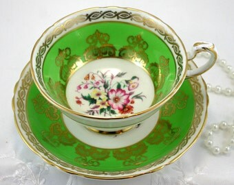Special Edition Paragon Teacup & Saucer,Floral Pattern, Crisp Green Gilded Borders,Bone English China made in 1960s. .
