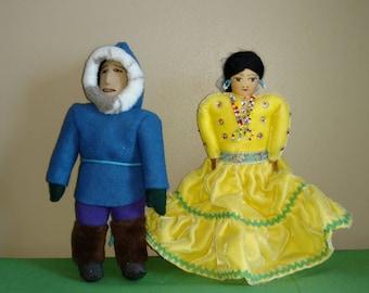 Two vintage unmarked international cloth Dolls