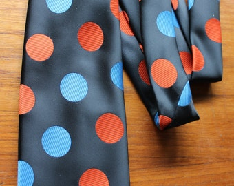 "Polka Dots Monsieur Bernard Themed Necktie -- Orange, Blue On Black -- Switzerland -- Round, Circle, Novelty--  4"" x 54-- Polyester"