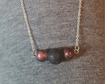 Beautiful lava diffuser necklace with purple accents
