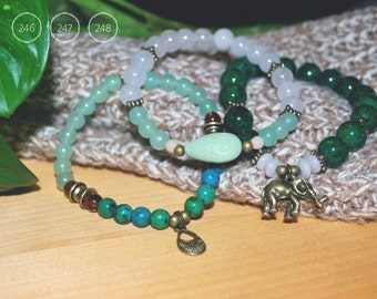 Bracelets in fine fossil stone, glass beads and white quartz balls