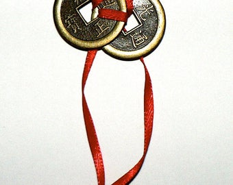 Three Good Fortune I-Ching Coins attached with Red Ribbon..Chinese I-Ching Coins Believed to Bring Good Luck, Wealth, Success, Happiness