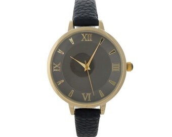 Black faux leather watch with a monochromatic face and Roman numerals