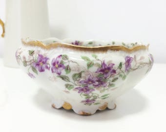 Vintage Limoges Charles H. Field Haviland, GDA, porcelain dish/bowl with purple clematis/flowers, gilded scalloped rim, and base