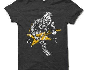 Bigfoot Shirt. Sasquatch Playing Guitar Shirt. Funny Cool T-Shirt.