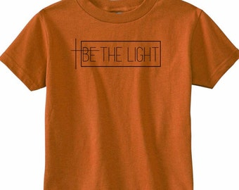 BE THE LIGHT//On Sale-Child Christian Graphic Tee, Kid Christian Shirts, Shine, Positivity, Cross, Faith TShirts, Give Them Jesus, Baby