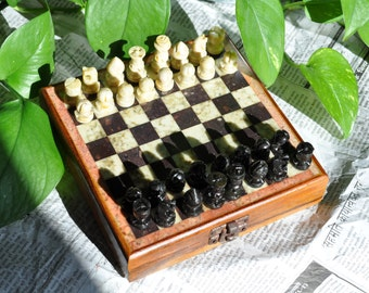 Trip to natural stone and exotic wooden chessboard