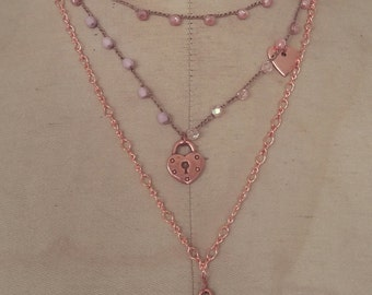 Long necklace made with copper chain and floss, crystals and copper charms