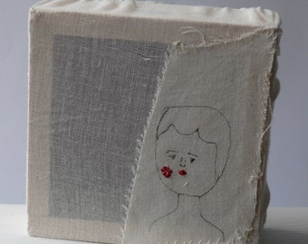 Square head embroidery stretched over a box frame
