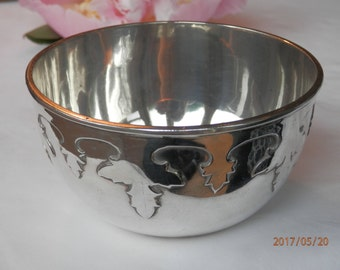 Silver Arts & Crafts christening bowl with foliate decoration.