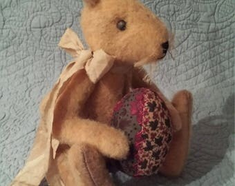 Primitive rabbit with quilted egg