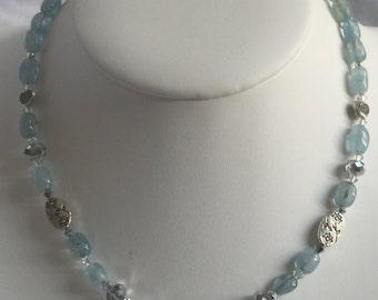 Acute Marine religious necklace
