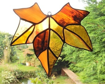 Stained glass maple leaf in browns/oranges