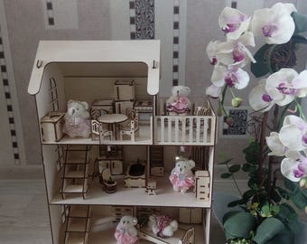 Wooden doll's house and its furniture