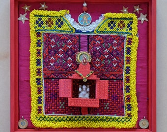 Collage with old embroidery from Kutch + Jagannath tempel with Ganesha in wooden frame
