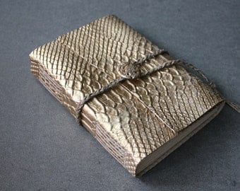 Golden python sketchbook   /  flashy journal with a braided cord.  Fountain pen friendly!