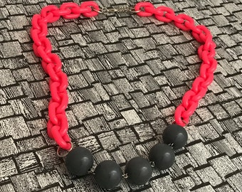 Plastic bling!  Neon pink necklace.