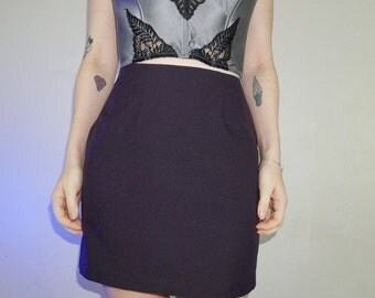 "90s midnight plum mini skirt by city triangles listed as a size 3, waist 25""."