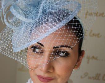 """Light Blue Fascinator - """"Noor"""" Light Blue Fascinator Hat Headband w/Ribbon waves a light blue birdcage veil"""