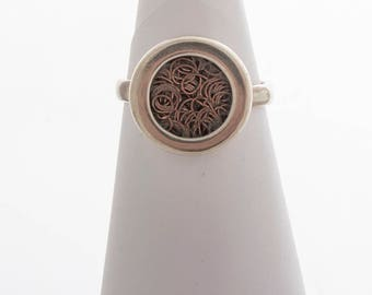 Handmade sterling silver and copper ring