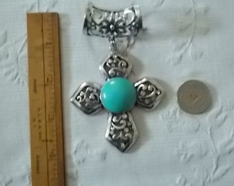331.  Silver tone Cross Pendant with faux turquoise center stone