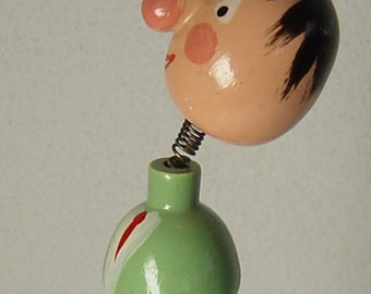 Cute vintage mechanical carved wooden bottle stopper man with shaking head