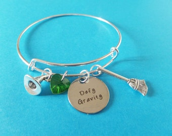 "WICKED Inspired silver tone 20mm laser tag "" defy gravity ""  65mm expandable bangle witches gift jewellery Uk"